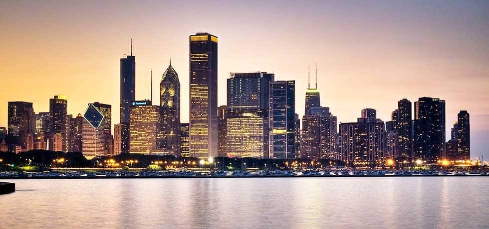Lighted Chicago skyline at dusk