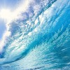 Blue tidal wave with sunbeam shining through