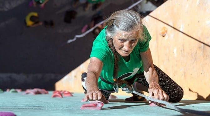 Woman Climbing Wall 672x372